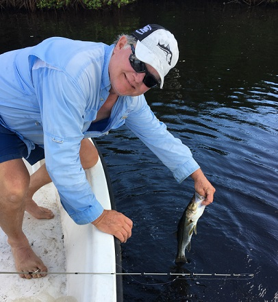 f2f4f2a2f4024a How ever we did have a school of white bait swim right up to the boat.  Blake could not stand it so he got out the cast net and smartly threw at ...